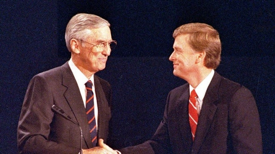 Sen. Lloyd Bentsen, left, D-IN, and Sen. Dan Quayle, R-TX, shake hands after their vice presidential debate in Omaha, Neb., Oct. 5, 1988.  (AP Photo/Ron Edmonds)