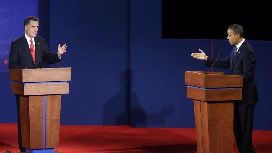 Oct. 3- Republican presidential candidate, former Massachusetts Gov. Mitt Romney, left, and President Barack Obama, right, debate at the University of Denver.