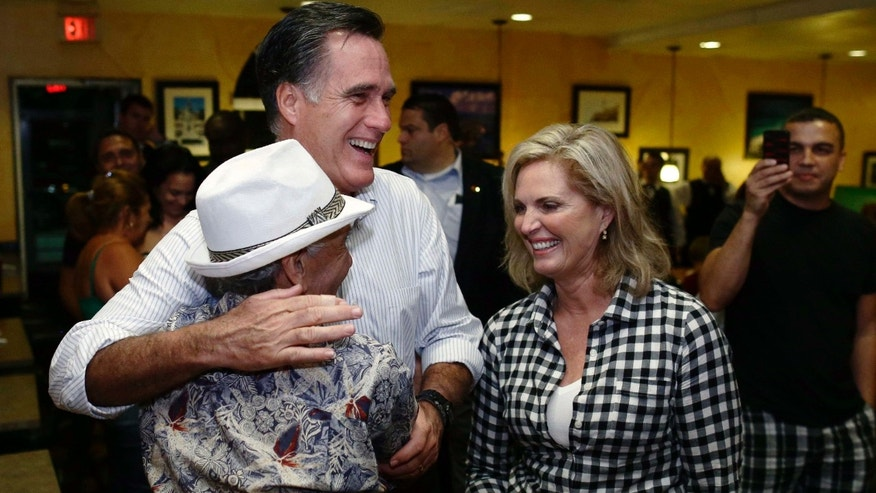 Oct. 5, 2012: Mitt Romney gets a hug from a patron as he campaigns with wife Ann during an unscheduled stop at La Teresita, a Cuban restaurant, in Tampa, Fla.