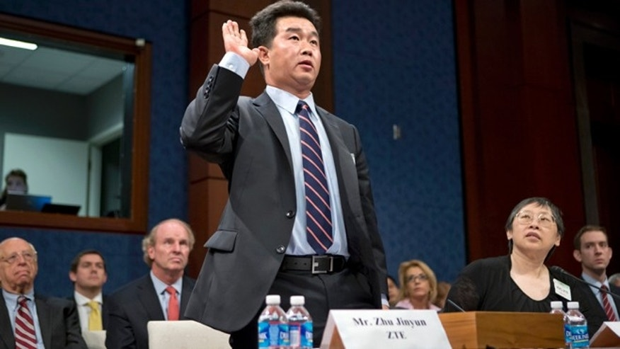 Sept. 13, 2012: Zhu Jinyun, ZTE Corporation's senior vice president for North America and Europe, is sworn in on Capitol Hill.