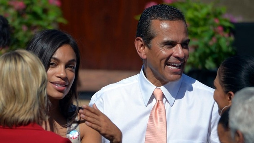 Oct. 8, 2012: Actress Rosario Dawson, left, along with Los Angeles mayor Antonio Villaraigosa as they wait for President Barack Obama to announce the establishment of the Cesar E. Chavez National Monument in Keene, Calif.