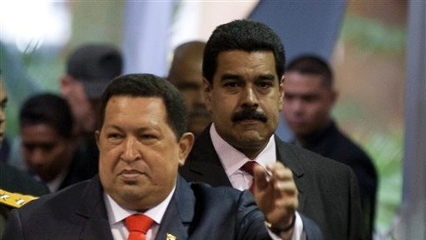 Nicolas Maduro, right, follows Venezuela's President Hugo Chavez as they arrive to the presidential ceremony.