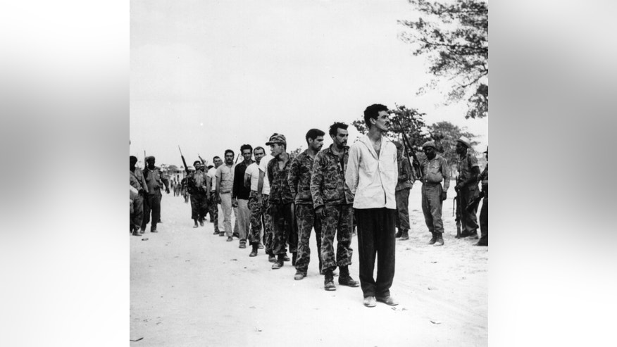 A group of captured Cubans are lined up by Castro's soldiers on the Playa de Giron, Cuba, mid-late April, 1961.  They are of the US-backed force of Cuban exiles (known as Brigade 2506) who attempted invasion at the Bay of Pigs.   (Photo by Three Lions/Getty Images)