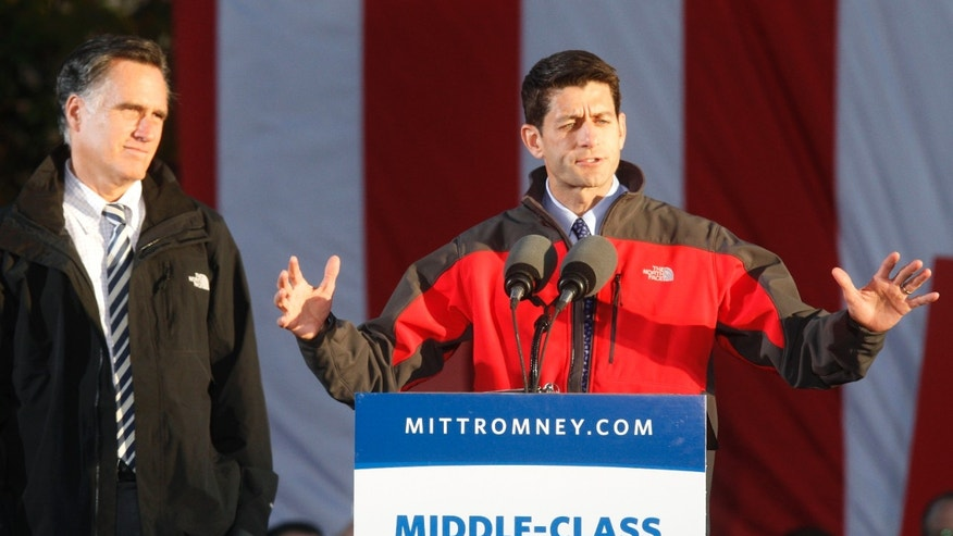 Friday, Oct. 12, 2012: Republican vice presidential candidate Rep. Paul Ryan, R-Wis., speaks as Mitt Romney listens during a rally in Lancaster, Ohio.