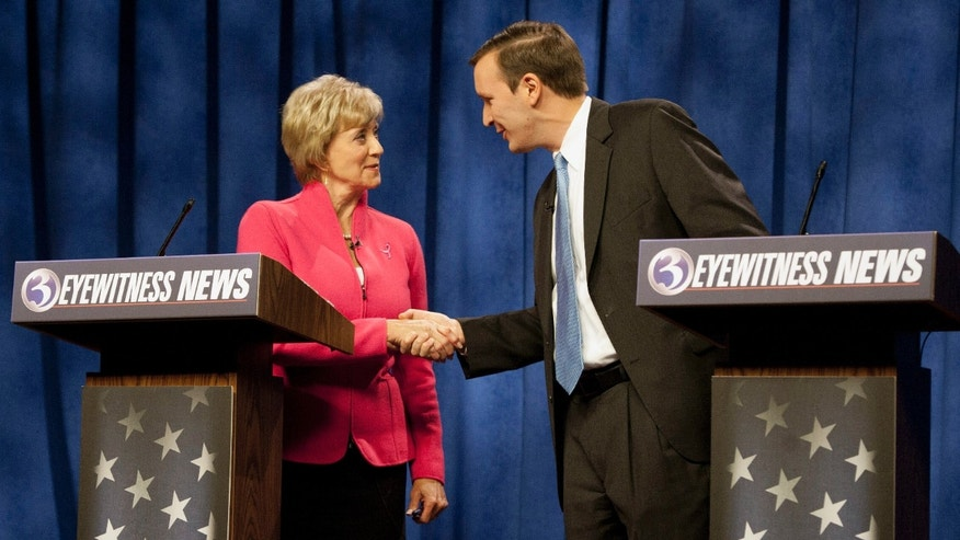 FILE: Oct. 7, 2012: U.S. Senate candidates for Connecticut, Republican Linda McMahon and Democratic Rep. Chris Murphy, D-Conn., after a debate in Rocky Hill, Conn.