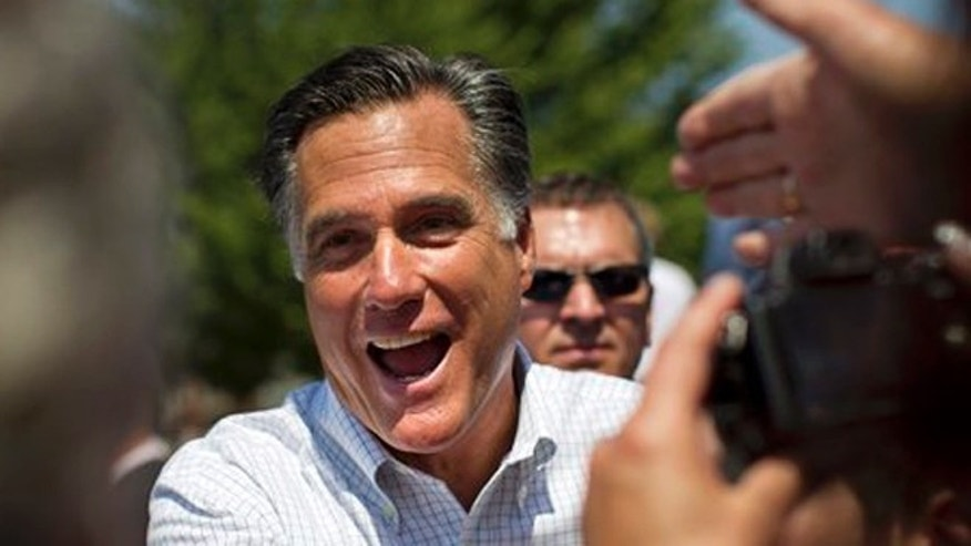 FILE: June 8, 2012: Supporters of Mitt Romney reaches out to shake his hand during a campaign stop in Council Bluffs, Iowa.