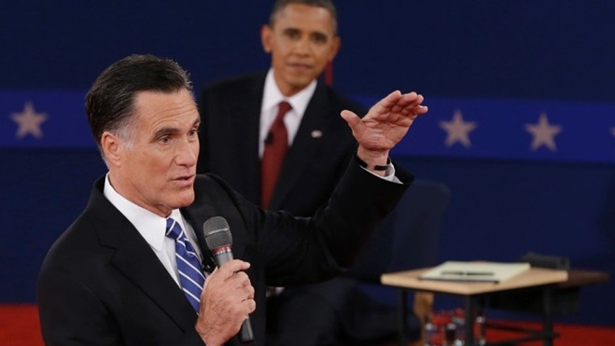 Oct. 16, 2012: President Barack Obama listens as Republican presidential nominee Mitt Romney speaks during the second presidential debate.