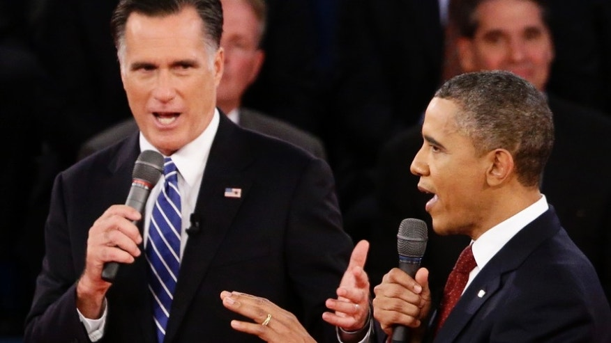 FILE: Oct. 16, 2012.: President Obama and Republican presidential nominee Mitt Romney in the second presidential debate at Hofstra University in Hempstead, N.Y.