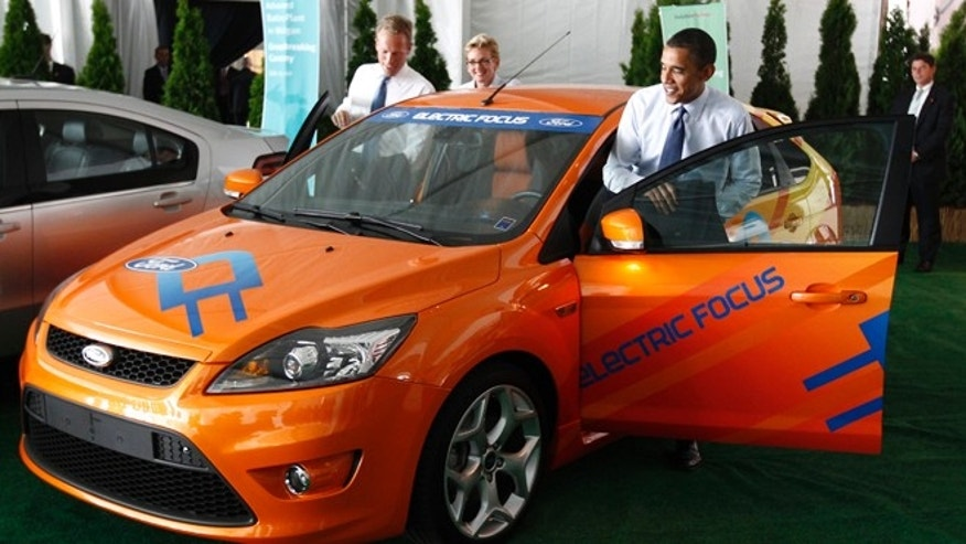 July 15, 2010: President Obama gets into an electric Ford Focus as he attends the groundbreaking of a factory for Compact Power Inc. in Holland, Mich.