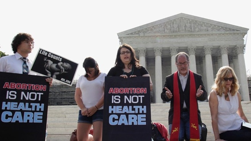 FILE: June 25, 2012: Pro-life activists rally in front of U.S. Supreme Court in Washington.