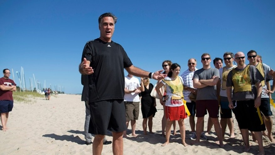 Oct. 21, 2012 : Mitt Romney before the start of a flag football game between between reporters that cover Romney, and Romney staff in Delray Beach, Fla.
