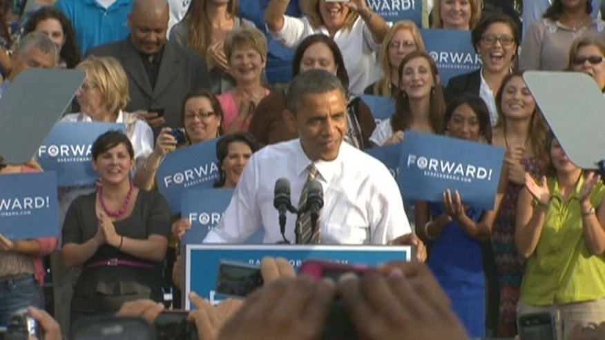 PLAY 'FIND THE GUYS': President Obama revs up a Tampa crowd on Oct. 25, 2012, with women supporters filling up the risers behind him -- as both candidates appeal to female voters.