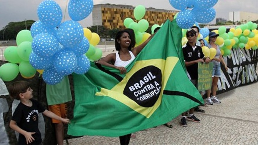 Members of an anti-corruption group protest in front of the Brazil's supreme court building calling for clean government, in Brasilia, Brazil.