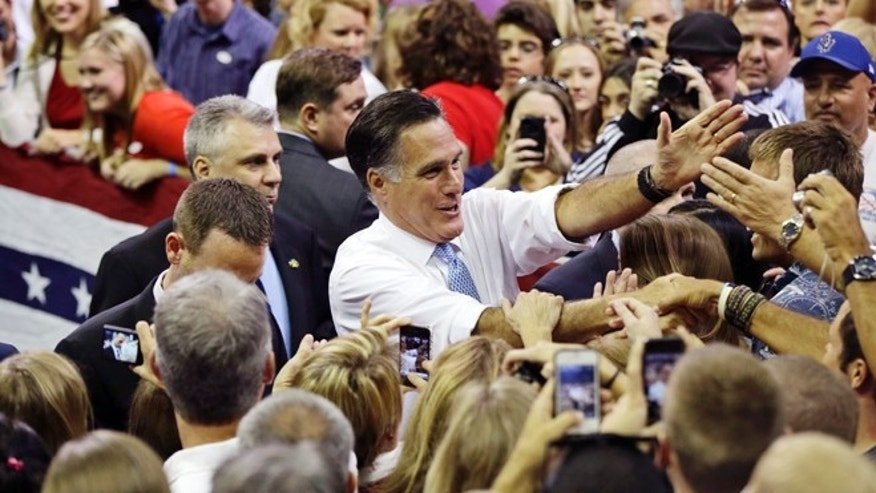 Saturday, Oct. 27, 2012: Mitt Romney greets supporters as he campaigns at the Pensacola Civic Center in Pensacola, Fla.