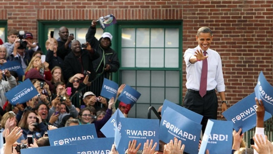 Oct. 27, 2012: President Obama waves to supporters at a campaign event in Nashua, N.H.