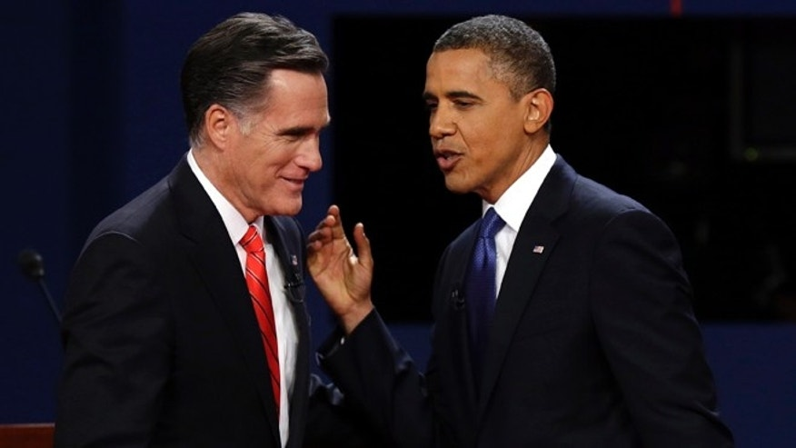 FILE: Oct. 3, 2012: Mitt Romney and President Obama talk after their debate at the University of Denver, in Denver.