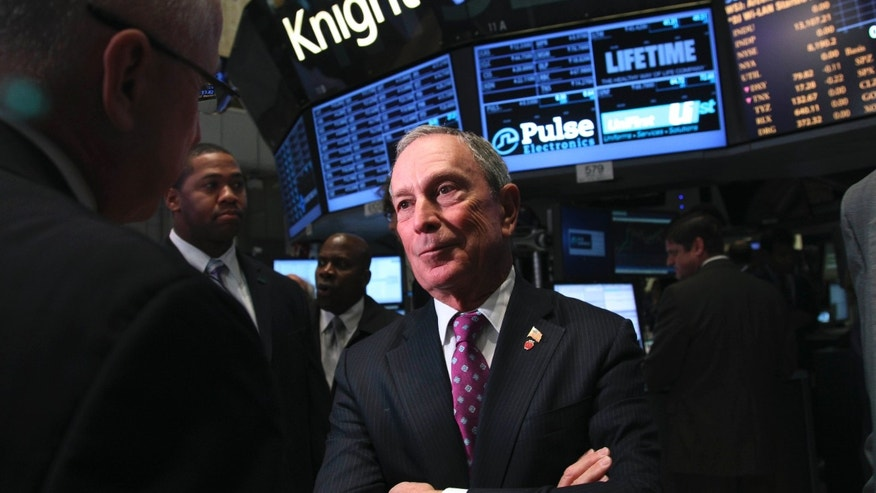 Oct. 31, 2012: New York City Mayor Michael Bloomberg talks to traders at the New York Stock Exchange in New York. Bloomberg backed President Barack Obama over Republican Mitt Romney on Thursday, saying the president will bring leadership critically needed to fight climate change in the wake of Hurricane Sandy.