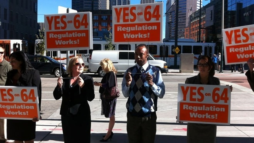 Oct. 15, 2012: Demonstrators in Denver hold signs in support of Amendment 64, a ballot measure that would partially legalize marijuana.