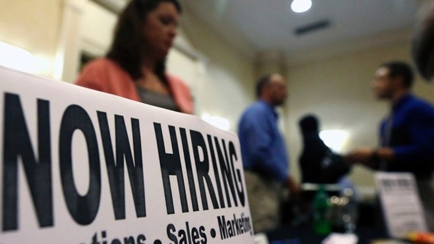 Oct. 25, 2012: A sign attracts job-seekers during a job fair at the Marriott Hotel in Colonie, N.Y.