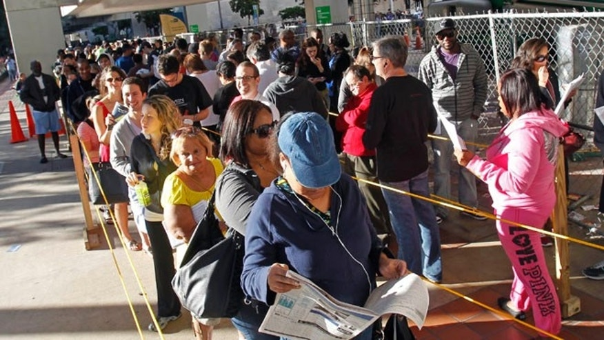 Saturday, Nov. 3, 2012: South Floridians stand in line during the last day of early voting in Miami.