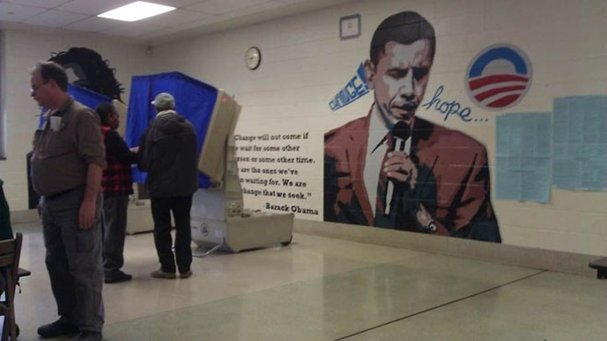 Shown here is a polling site in Philadelphia with a mural of President Obama.