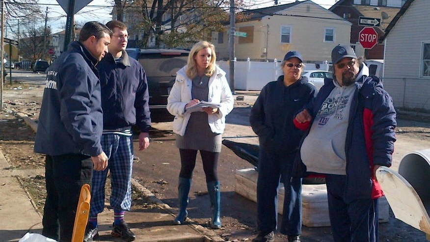 Rep. Michael Grimm (R-NY) spends election day visiting storm victims in his district. He talks to Tarek Moustafa and MaryLou Wong of Hempstead Ave, in Midland Beach Staten Island. The family lost everything in storm. (FoxNews.com/Jana Winter)