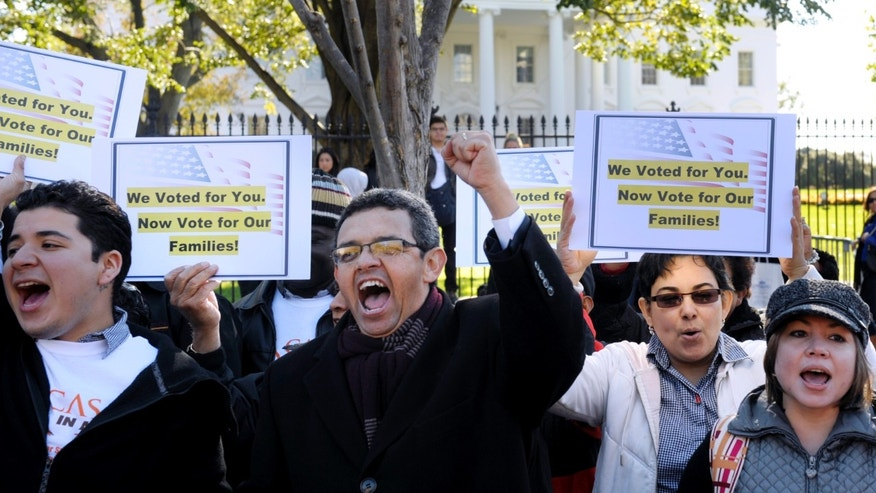 Gustavo Torres, director, Casa in Action, center, and others, chant during a rally of immigration rights organizations, including Casa in Action and Maryland Dream Act, in front of the White House in Washington, Thursday, Nov. 8, 2012, calling on President Barack Obama to fulfill his promise of passing comprehensive immigration reform. (AP Photo/Cliff Owen)