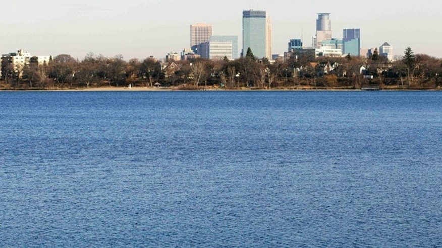 Nov. 13, 2012: The city of Minneapolis skyline rises in the distance behind Lake Calhoun.
