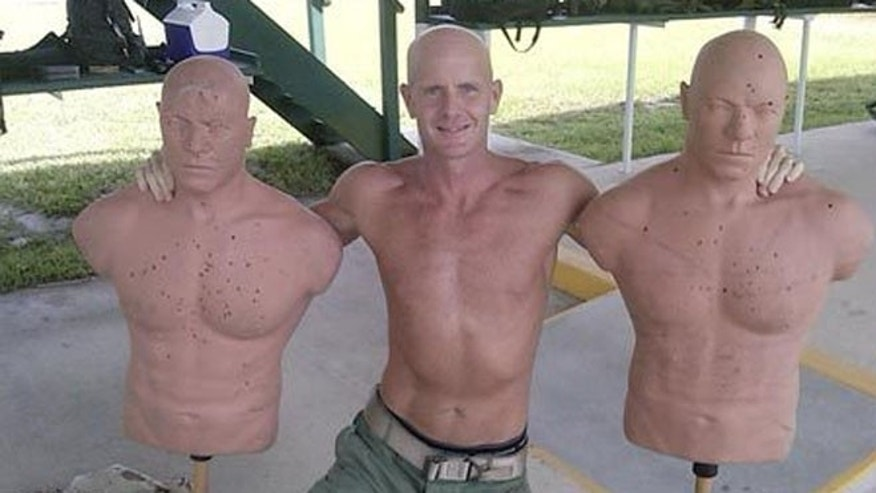 Shown here is FBI Special Agent Frederick W. Humphries, posing with two dummies in the photo that has been mentioned as part of the review into his conduct related to the Petraeus scandal. Humphries sent this photo to Jill Kelley, the Tampa socialite who originally touched off the FBI probe that uncovered Petraeus' affair.