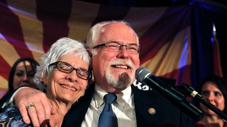 FILE: Nov. 6, 2012: Rep. Ron Barber, D-Ariz., hugs his wife Nancy Barber while speaking with supporters at a Democratic Party gathering.
