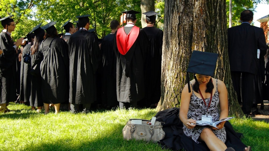 May 24, 2012: Graduating student Jennifer Lim sits before the start of the commencement exercises at Harvard University in Cambridge, Mass.