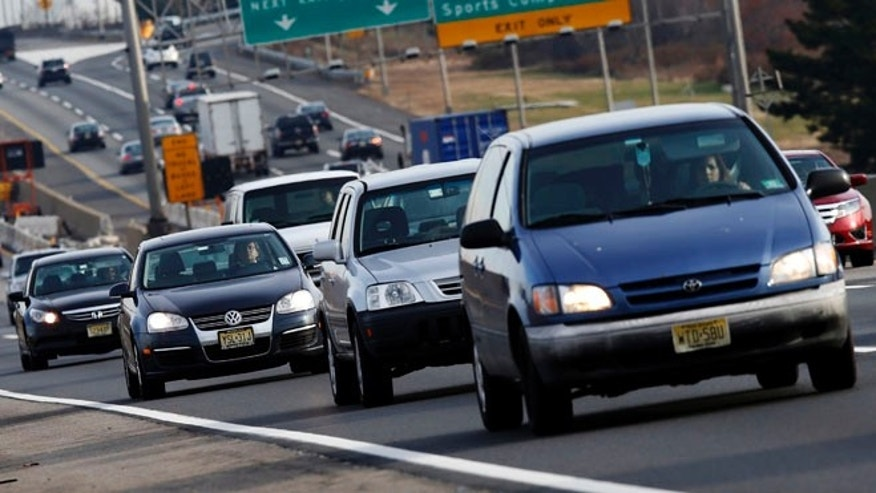 FILE: Tuesday, Nov. 20, 2012: Cars travel on the New Jersey turnpike near Elizabeth, New Jersey.