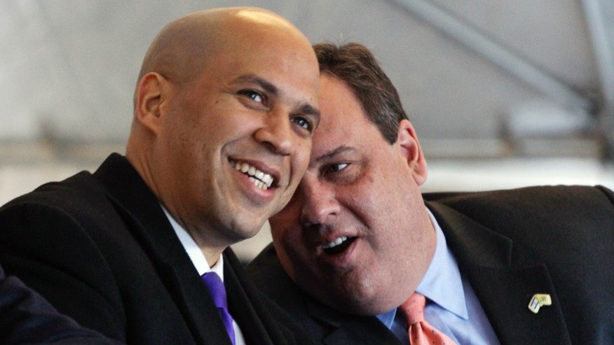 FILE: Feb. 9, 2012: New Jersey Gov. Chris Christie, right, talks with Newark Mayor Cory A. Booker during groundbreaking ceremonies in downtown Newark, N.J.