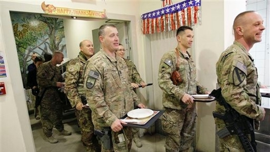 Nov. 22, 2012: U.S. soldiers and NATO service members stand in line for a Thanksgiving meal at the U.S.-led coalition base in Kabul.