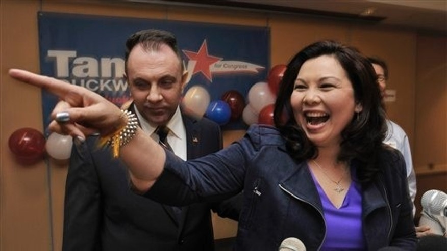 In this Nov. 6, 2012 file photo taken in Elk Grove Village, Ill., U.S. Rep. elect for the Illinois' 8th congressional district Tammy Duckworth, celebrates on election night with husband Bryan Bowlsbey after defeating U.S. Rep. Joe Walsh.