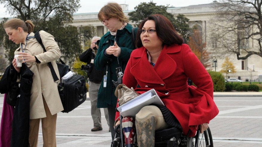 FILE: Nov. 15, 2012: Rep.-elect Tammy Duckworth, D-Ill., an Iraq War veteran arrives at the U.S. Capitol in Washington