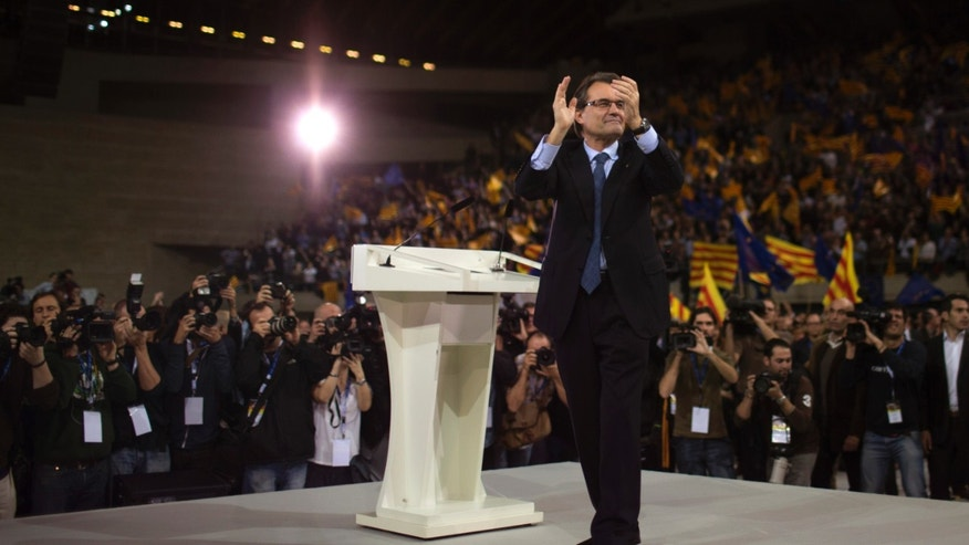 The leader of center-right Catalan Nationalist Coalition (CiU), Artur Mas, thanks his supporters during the last day of campaigning in a meeting in Barcelona, Spain, on Friday, Nov. 23, 2012. (AP Photo/Emilio Morenatti)