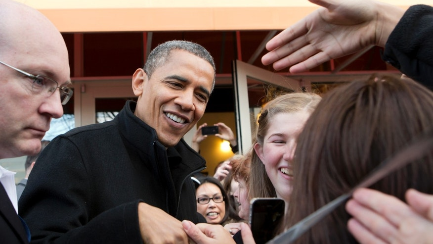 FILE: Saturday, Nov. 24, 2012: President Barack Obama outside a small bookstore in Arlington, Va.,  where he went shopping with his daughters.