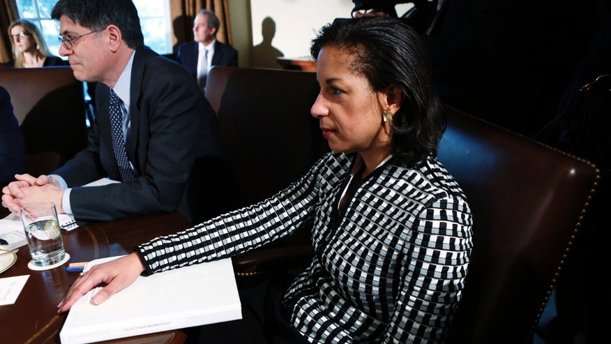 November 28, 2012: U.S. Ambassador to the United Nations Susan Rice listens to President Obama speak during a Cabinet meeting at the White House in Washington.