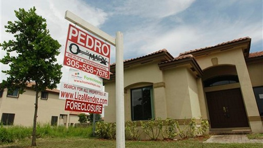 In this file photo, a house in Homestead, Fla., sits empty for sale as a foreclosure home.