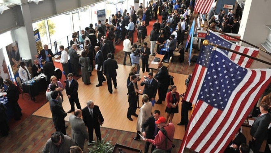 Dec. 5, 2012: Hundreds of veterans and military spouses meet with prospective employers at the Hiring Our Heroes DC job fair at Nationals Park in Washington, D.C.