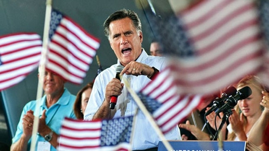 Mitt Romney speaks at a rally.