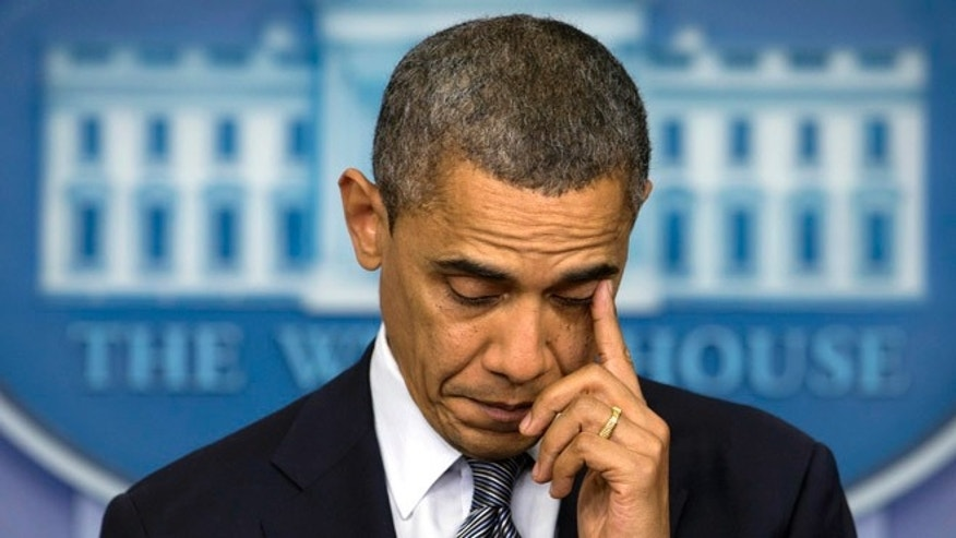 Dec. 14, 2012: President Obama wipes his eye as he talks about the Connecticut elementary school shooting in the White House briefing room in Washington.