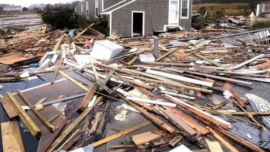 Oct. 30, 2012: Debris floats around a house pushed off its foundation in the aftermath of superstorm Sandy in East Haven, Conn.