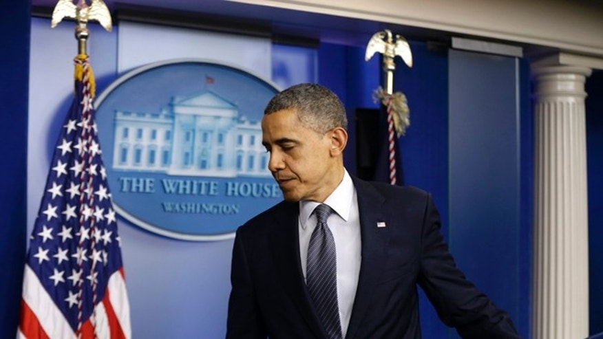FILE: Dec. 14, 2012: President Obama leaves the White House Briefing Room after speaking about the school shooting in Newtown, Conn.