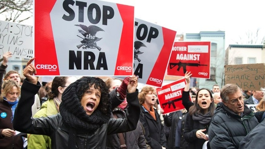 Dec. 17, 2012: Protesters rally against the National Rifle Association on Capitol Hill in Washington.