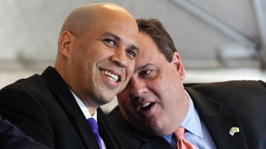 Feb. 9, 2012: New Jersey Gov. Chris Christie, right, talks with Newark Mayor Cory Booker, during a ceremony in Newark, N.J.