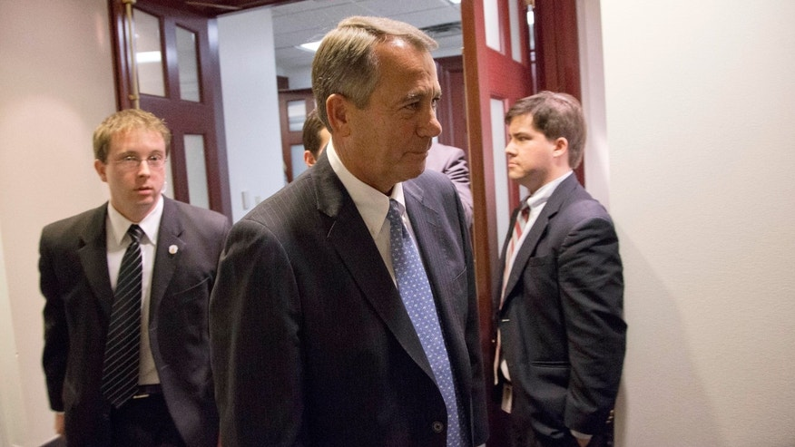 Speaker John Boehner of Ohio, center, departs after a House Republicans meeting on Capitol Hill, Thursday, Dec. 20, 2012 in Washington.