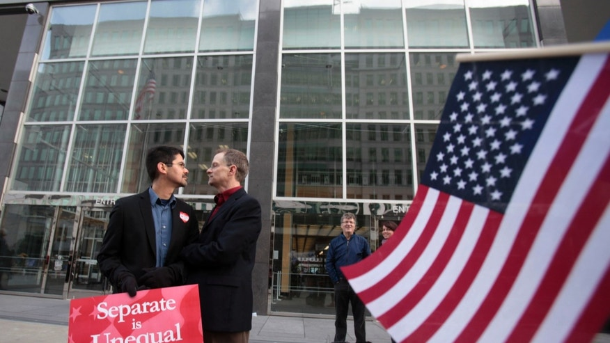 Jan. 11, 2010: In this file photo from Stuart Gaffney, left, and John Lewis, same-sex partners for 22 years, huddle outside of the federal courthouse in San Francisco.