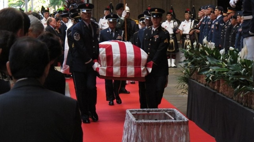 Dec. 22, 2012: Pallbearers carry the casket of U.S. Sen. Daniel Inouye into the courtyard of the Hawaii state Capitol during a visitation ceremony in Honolulu.